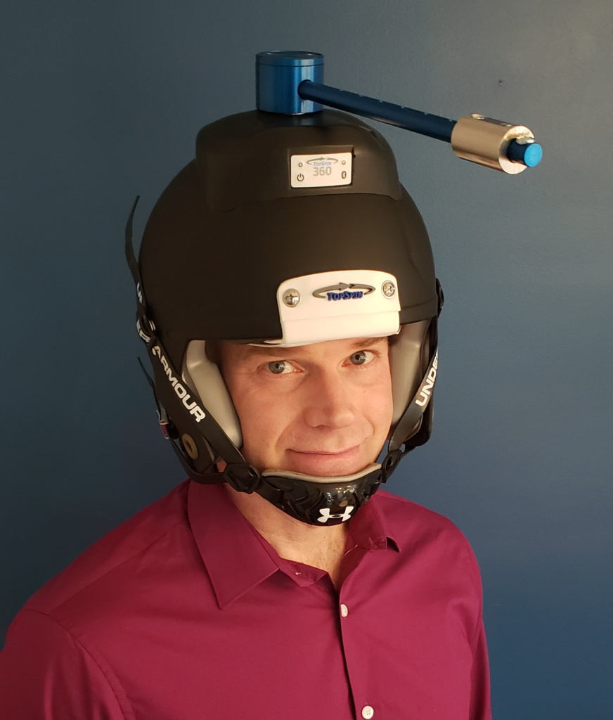 Dr. Theo wearing TopSpin 360 helmet